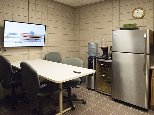 Private food storage and wide screen TV in Kitchenette